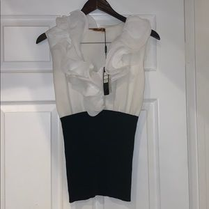 A ruffled black and white stretchy blouse.